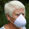 Femme qui porte Le Grand Masque